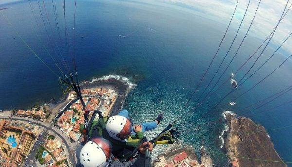 Paraglider flies over Costa Adeje