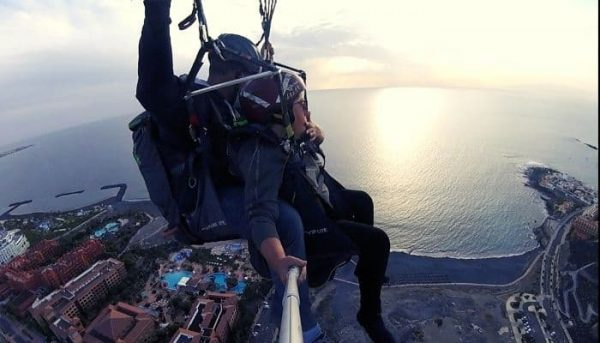 Woman enjoys a paragliding flight in Tenerife