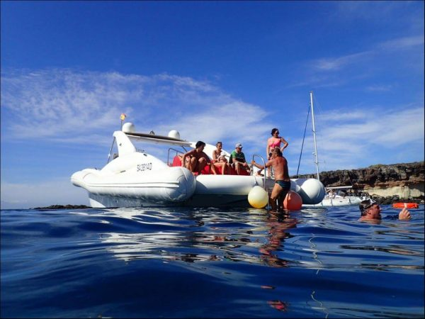 People take a break during the luxury yacht tour in Tenerife