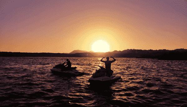 Guys enjoying the sunset on a jet ski in tenerife