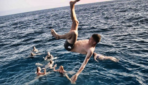 Guy jumping in the water