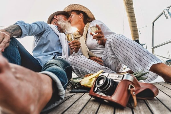 Couple is kissing during a boat excursion