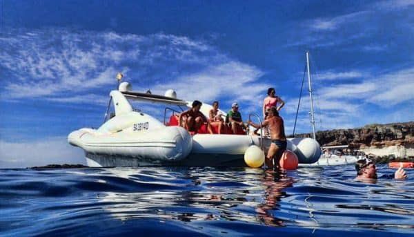 group of people who have rented a motor boat and enjoy themselves