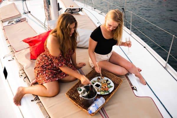 Girls enjoying sushi during a private boat trip in Tenerife