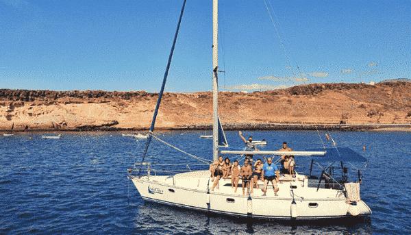Skyline boat sailing along the coast of Tenerife