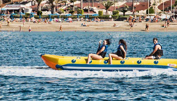 3 people riding a banana boat