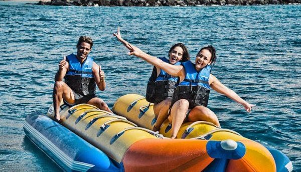 group of friends enjoying banana boat