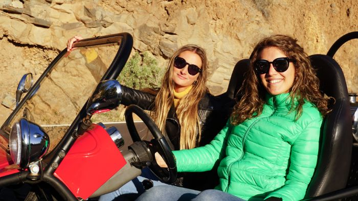 Girls sitting in a buggy