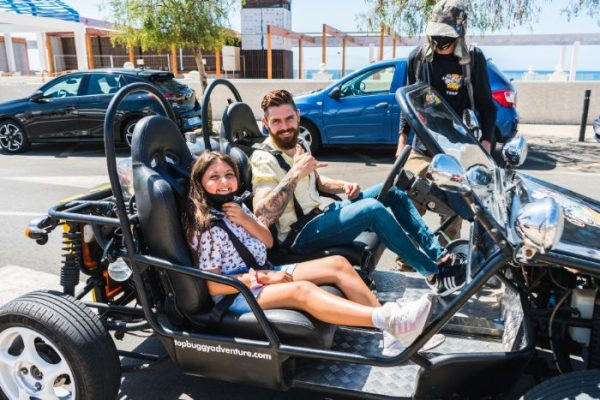 Father and daughter going on a buggy tour in Tenerife