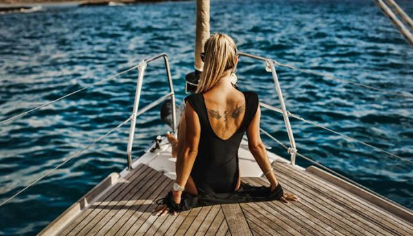 Girl sitting in the front of the boat