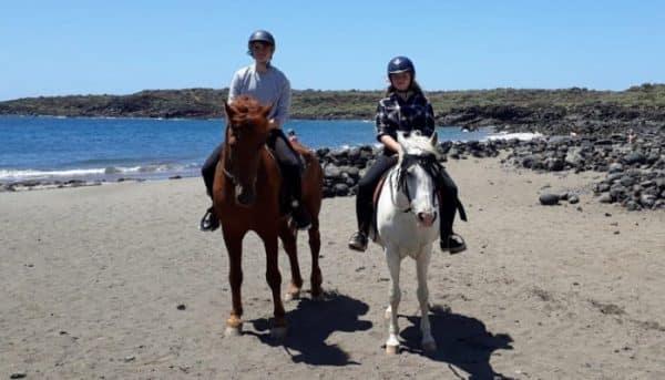 Horse riders on a beach near Las Galletas