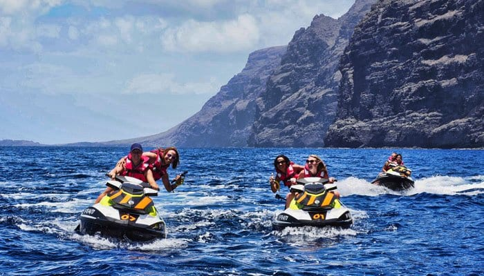 3 jet ski's near the cliffs of Los Gigantes