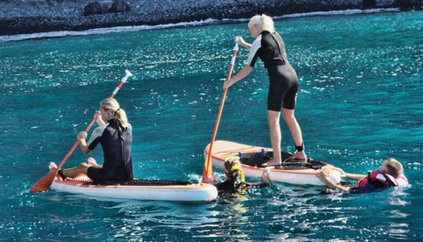 people trying standup paddling