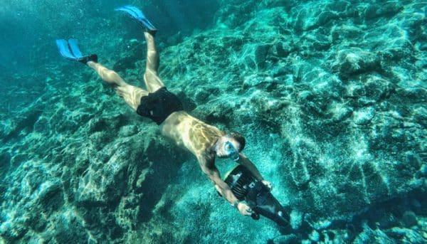 Man snorkeling with a aqua jet