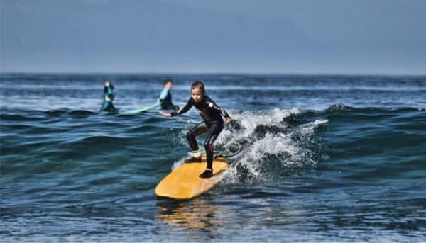 Boy is learning how to surf