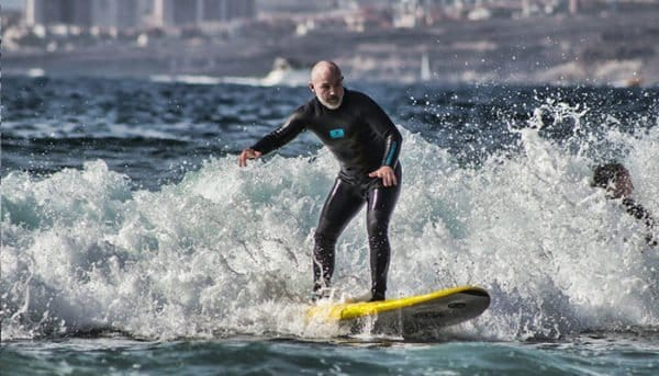 man is learning how to surf