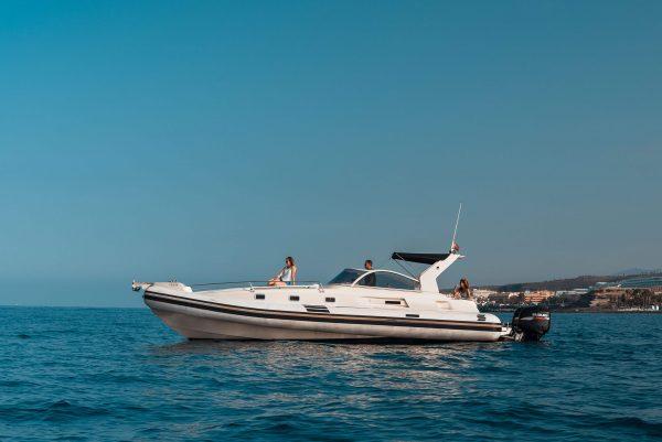 a luxury speed boat on the water near Costa Adeje