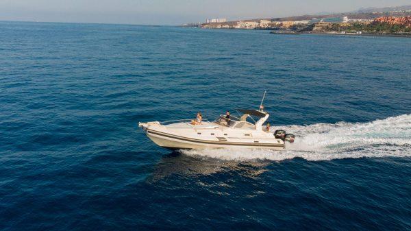 Speed boat cruising along coastline of Costa adeje