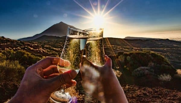 Two glasses cheering during sunset in Teide National Park