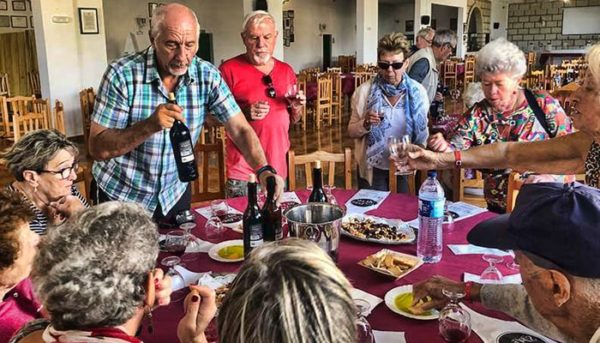 Group of people eating and tasting wine