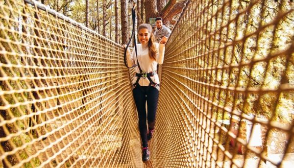 Girl on a bridge made of ropes