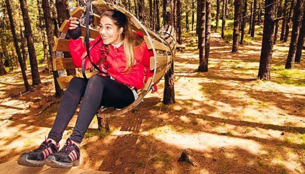 Girl in a barrel in outdoor park