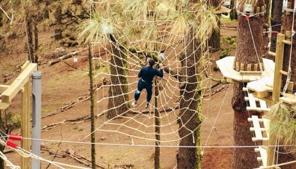 Boy climbs a spider web made of string