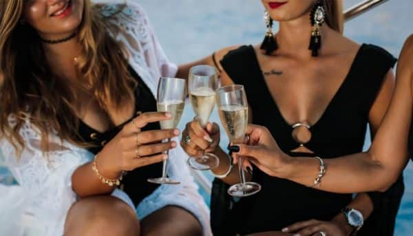 Girls toasting with champagne on a boat trip