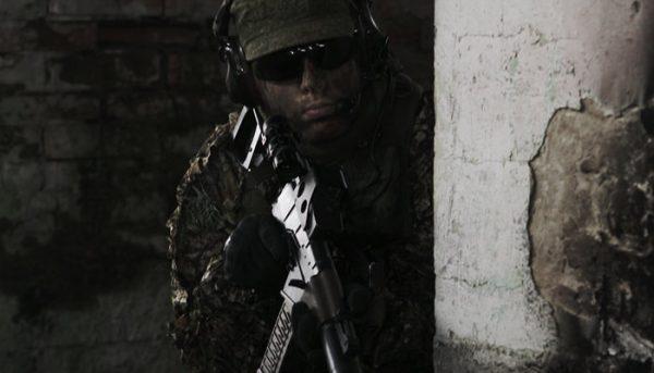 man playing airsoft