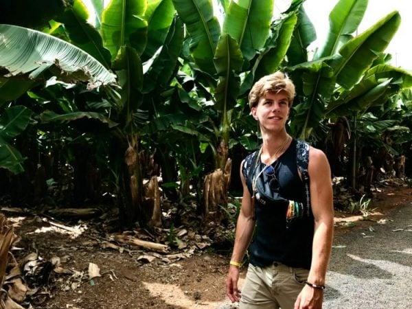 Boy walking through a banana plantation in Tenerife