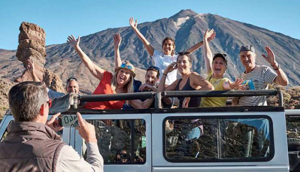 Group of people have fun during a jeep safari at El Teide