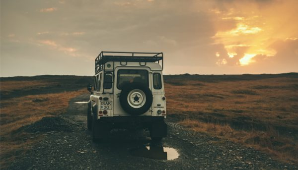 Jeep driving through beautiful nature