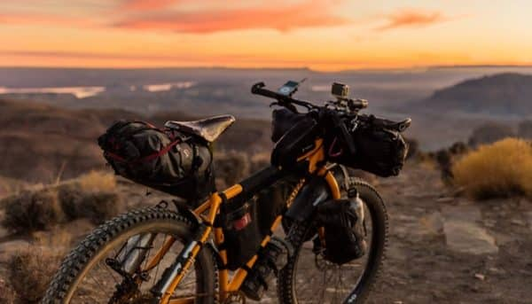 Mountain bike on a mountain with sunset in the background