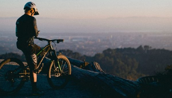 Cyclist has a break on a mountain
