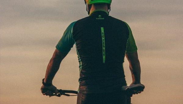 Back of a man on a mountain bike
