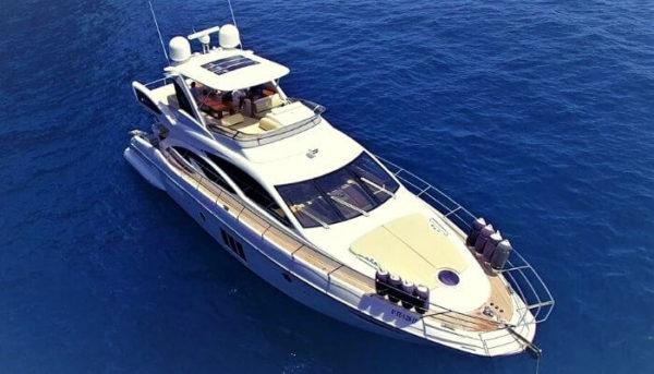 Yacht cruising along the coast of Costa Adeje