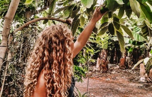 A girl enjoying a tour of a banana plantation